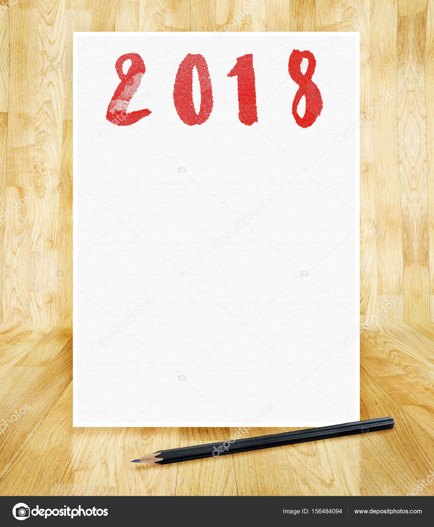 Feliz año nuevo 2018 en blanco papel marco con lápiz en la mano bru ...