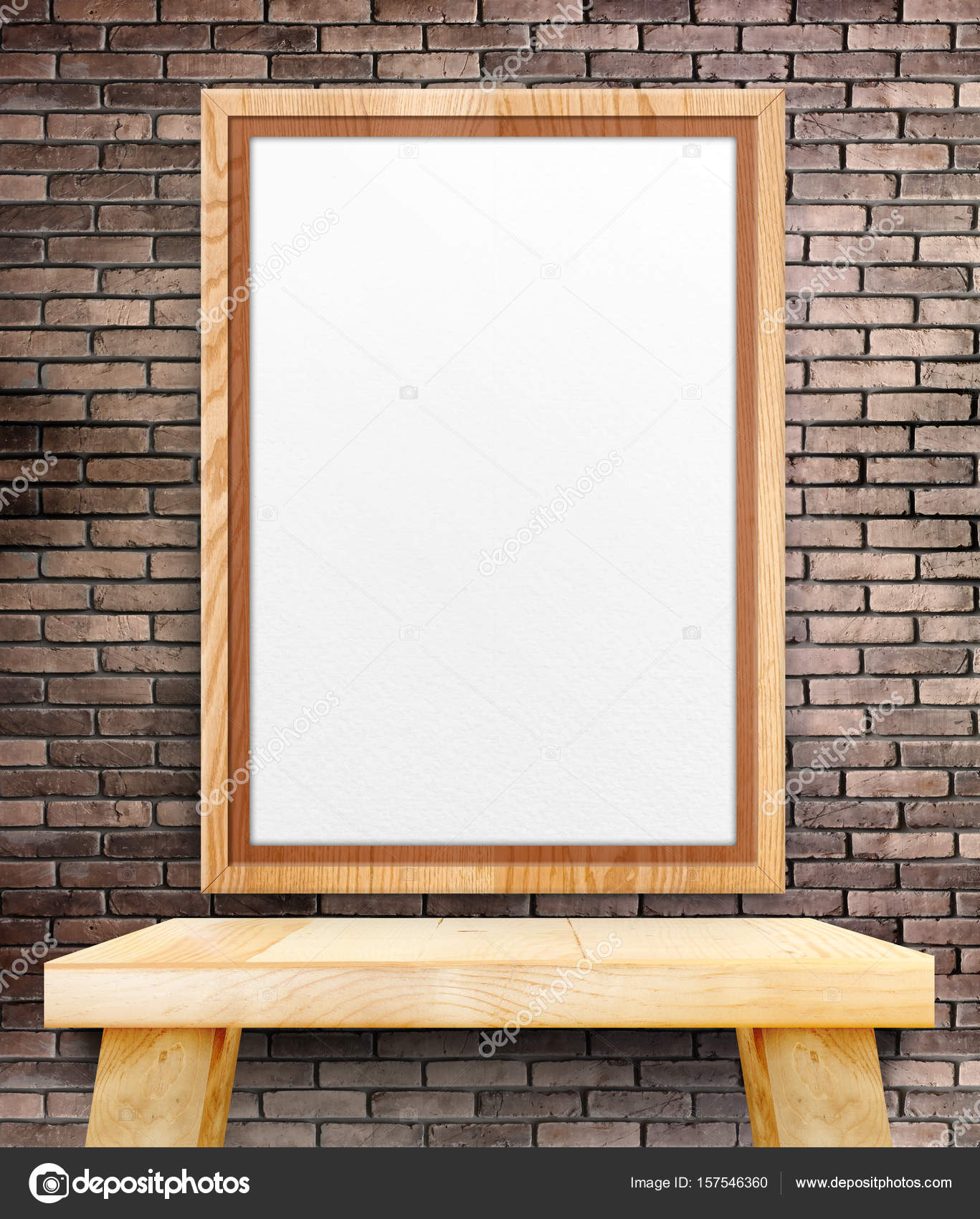 Blank wooden photo frame hanging at red brick wall over wood tab ...