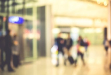 Blurred background,Traveler with baggage at Terminal Departure C