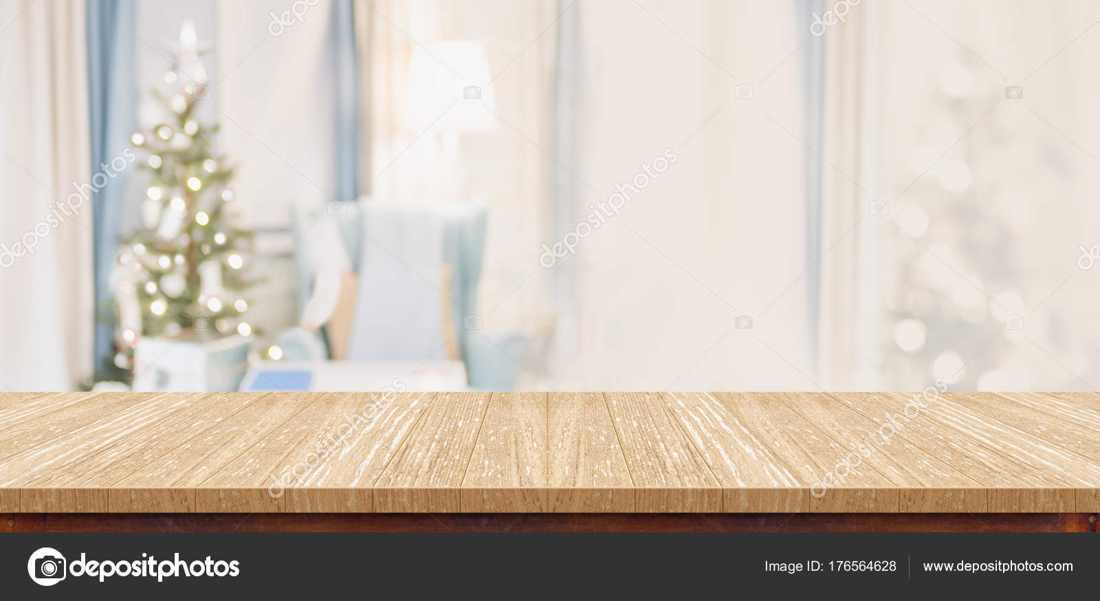 Empty wood table top with abstract warm living room decor with c ...
