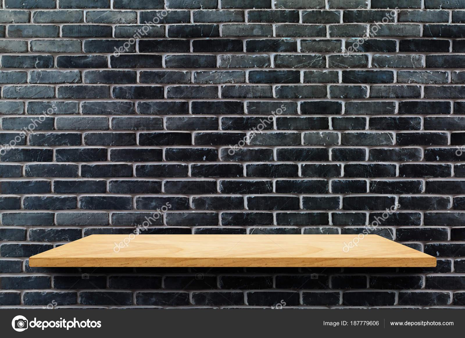 empty wood board shelf at black brick wall background mock up fo