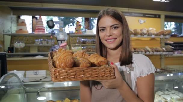 Woman smells croissants