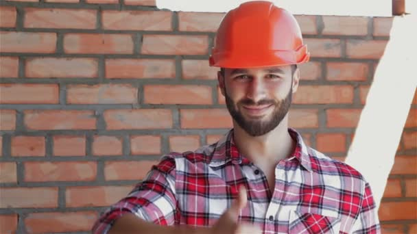 Male builder shows his thumb up