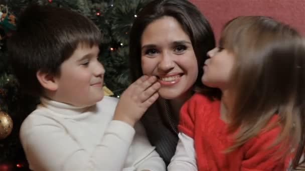 Children kiss their mother