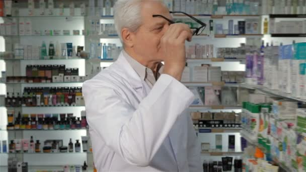 Male druggist wears glasses at the pharmacy