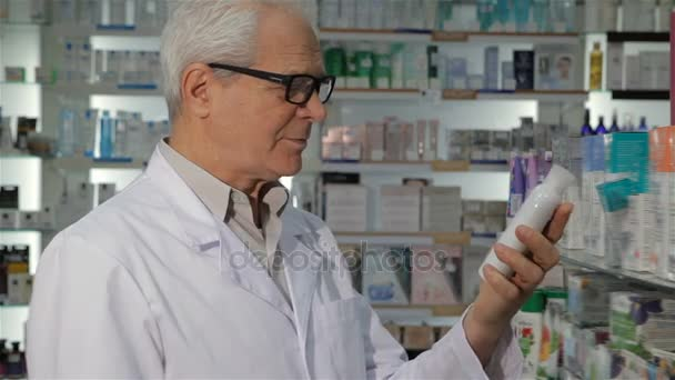 Male pharmacist takes off glasses at the drugstore