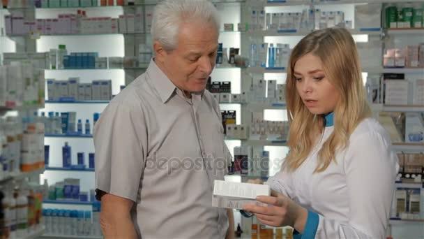 Female pharmacist tells customer about the medicine