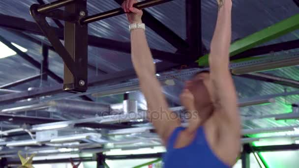 Woman does kipping pull ups