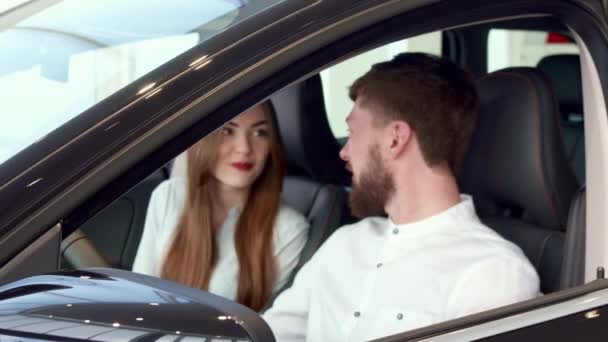Man shows car key through the window