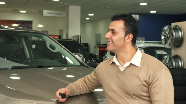 A good man examines the car salon and shows a thumbs up