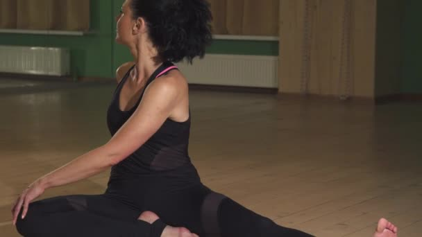 Gorgeous flexible woman stretching her body doing yoga