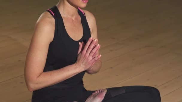 Gorgeous happy relaxed woman smiling to the camera after meditating