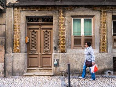 woman near old building in Bairro Alto