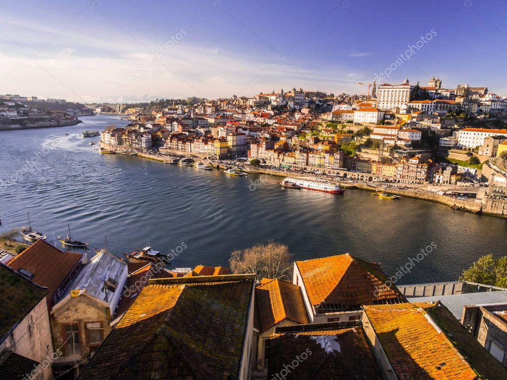 PORTO, PORTUGAL - FEBRUARY 12, 2018: View of old town seen from other side of Douro river, at sunset, Porto, Portugal