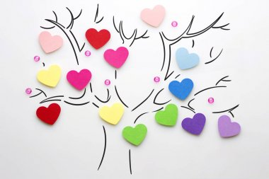 Love tree. Creative valentines concept photo of hearts on the tree on white background.