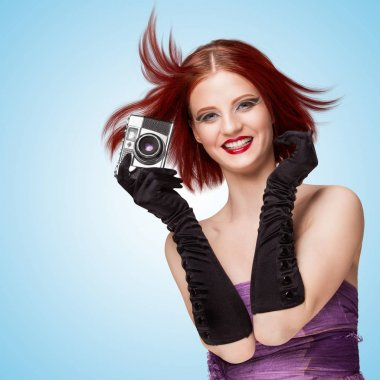 girl holding an old vintage photo camera