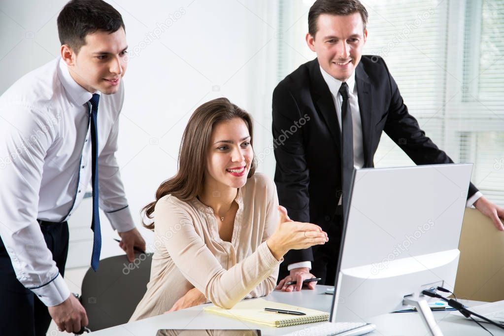 Group of business people working with computer in an office