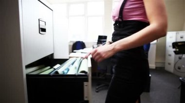 The Office: female office worker at filing cabinet