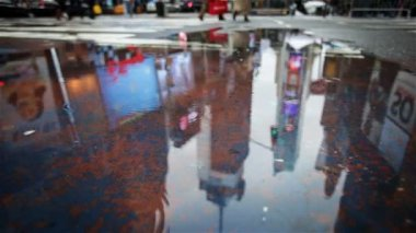 Times Square puddle reflection