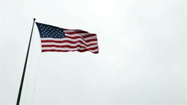 US Flag set against an overcast sky