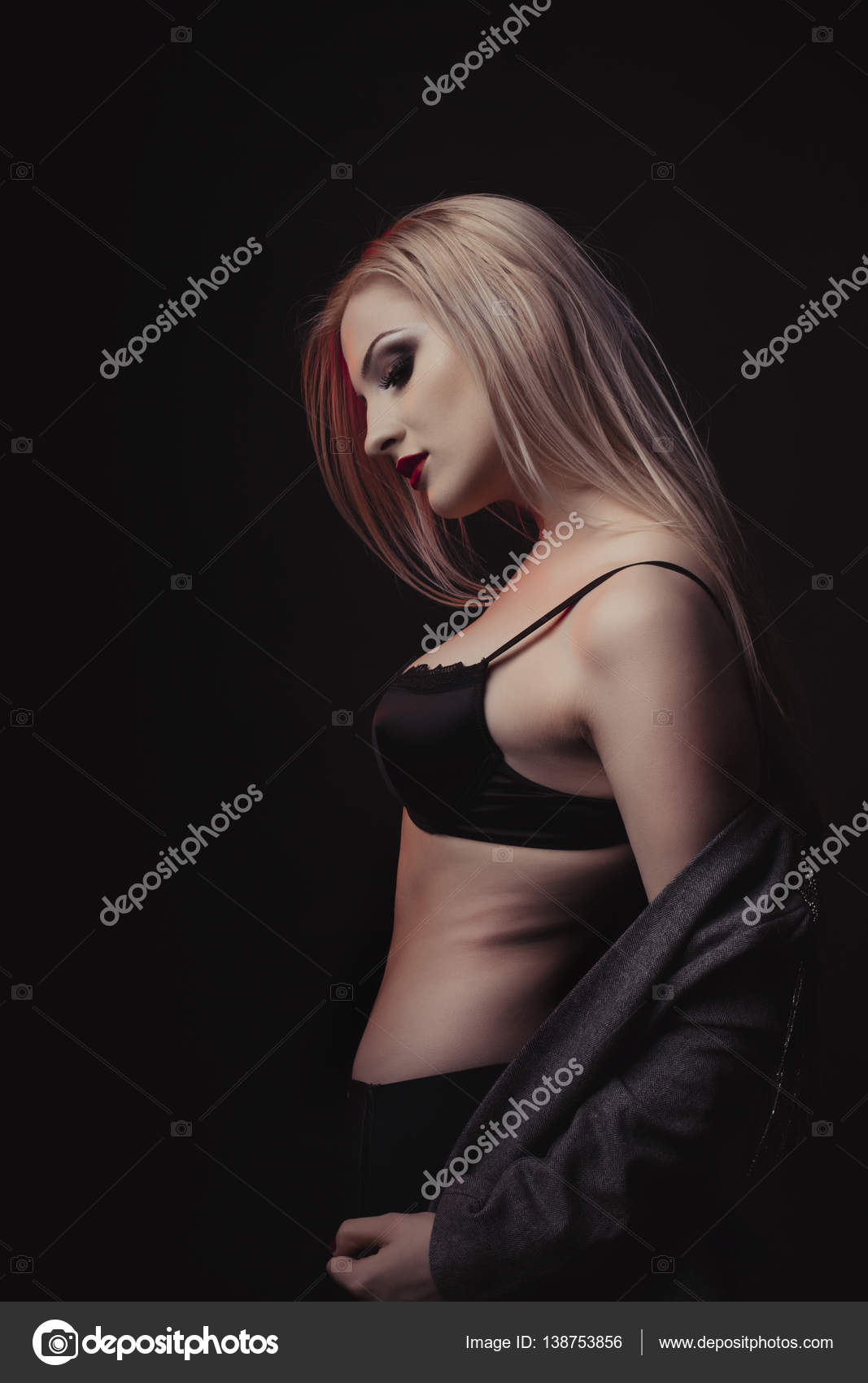 lovely young model in a black lingerie undressing — stock photo