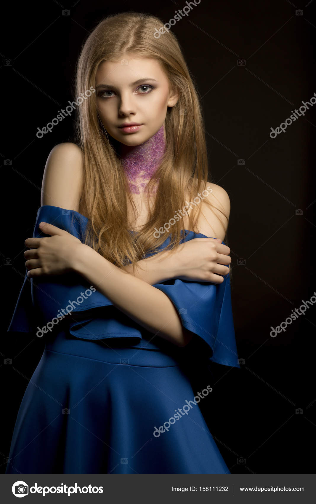 Attractive Blonde Woman With Creative Makeup And Dress With Nake Stock Photo