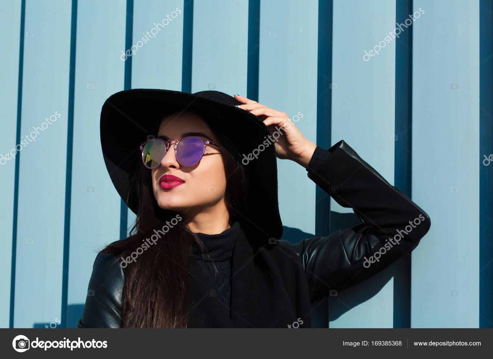 5ed92b193e9d Closeup portrait of young brunette woman in stylish glasses wears black hat.  Outdoor lifestyle portrait — Photo by vika-pavlyuk