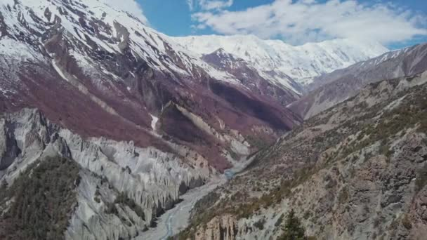 Incredible scenic mountain valley, snowy Tilicho Peak, red pagoda, Nepal