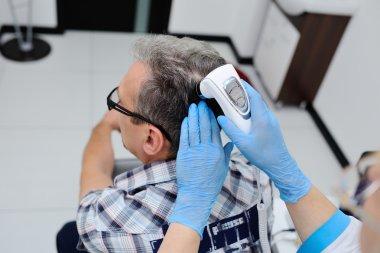 diagnostics hair and scalp. Trihoskopiya.