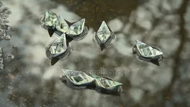 Paper ships out of dollars in water