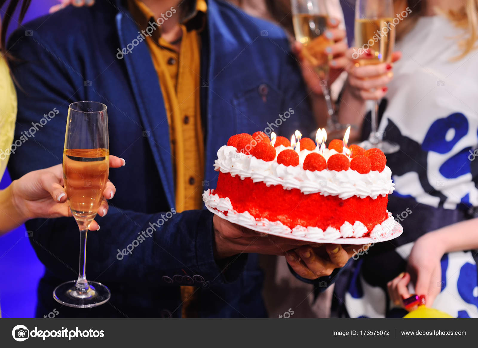Birthday Cake With Candles And A Glass Of Champagne Closeup