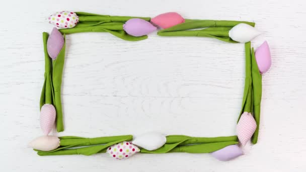 Animated frame of spring tulips flowers on a wooden background