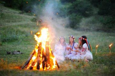 The celebration of the pagan Slavic holiday of Ivan Kupala Day or Midsummer.