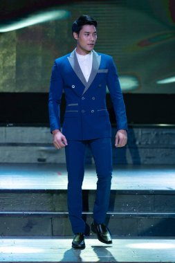 Bangkok, Thailand - August 28, 2019 ; Asian Man Contest named Mister Supranational Thailand 2019, Handsome Contestants present Fashion show in formal suit Dress at Suan Lum Night Bazaar Hotel