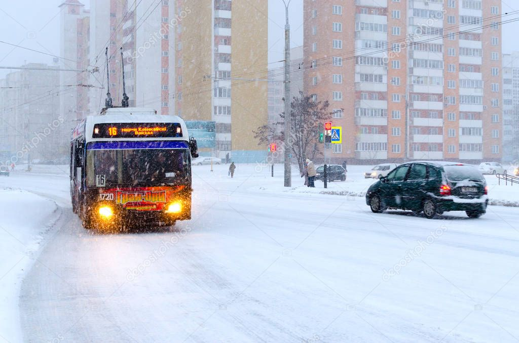 Trolleybus on city street during heavy snowfall