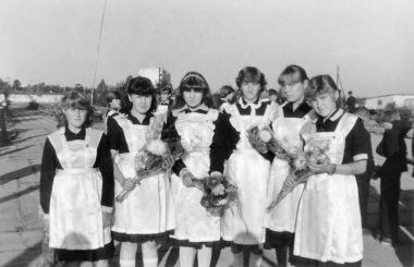 Schoolgirls in elegant school uniform on September 1st (1985), Belarus