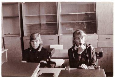 Two schoolgirls-tenth graders in classroom on break (1985), Senno, Belarus