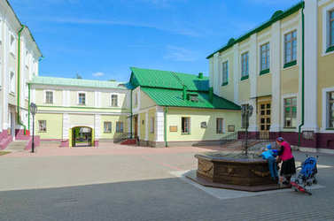 People are at ancient well in courtyard of Polotsk State University (complex of buildings of former Jesuit collegium), Polotsk, Belarus