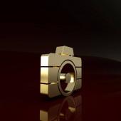 Zlatá ikona fotoaparátu izolované na hnědém pozadí. Ikona fotoaparátu. Minimalismus. 3D ilustrace 3D vykreslení