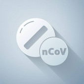 Paper cut Medicine pill or tablet icon isolated on grey background. Corona virus 2019-nCoV. Capsule pill and drug sign. Pharmacy design. Paper art style. Vector Illustration