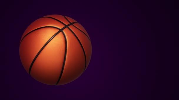 Animace pomalého otáčení oranžový míč pro basketbal hra s realistickou texturou a světlem na černém pozadí, bezešvé smyčky