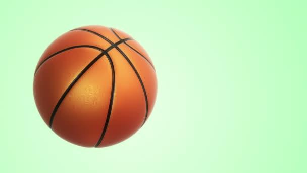 Animace pomalého otáčení oranžový míč pro basketbal hra s realistickou texturou a světlo na zeleném pozadí, bezešvé smyčky