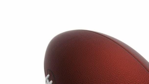 Animace pomalého otáčení míče pro americký fotbal, bezešvé smyčky