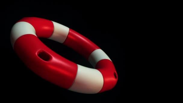 Animation der langsamen Rotation weißer und roter Rettungsring auf dunklem Hintergrund, Animation der nahtlosen Schleife