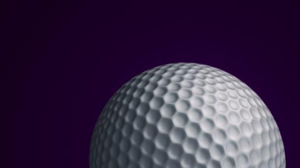 Animace pomalého otáčení míče pro golf. Pohled zblízka s realistickou texturou a světlem. Animace bezešvé smyčky.