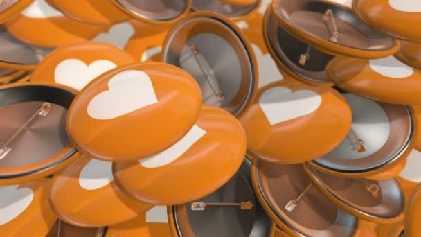 Animationsbewegung von bunten Abzeichen mit Herzsymbolen. Animation einer nahtlosen Schleife