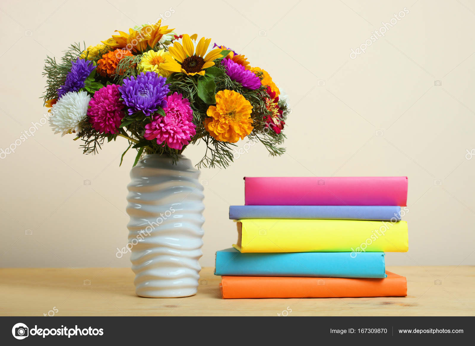 bouquet of beautiful flowers and a stack of books — Stock Photo ...
