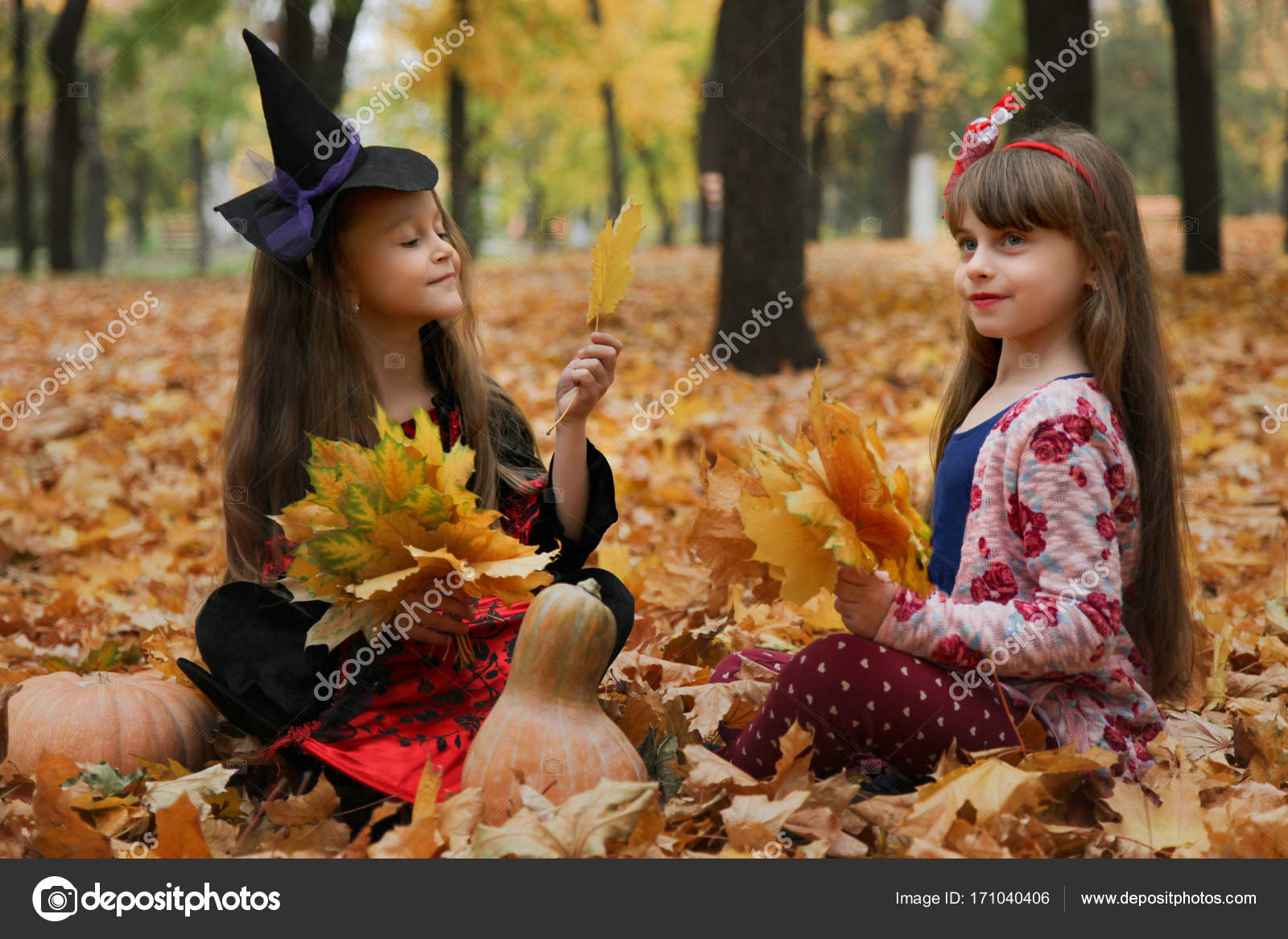 two girls in halloween costumes stock photo