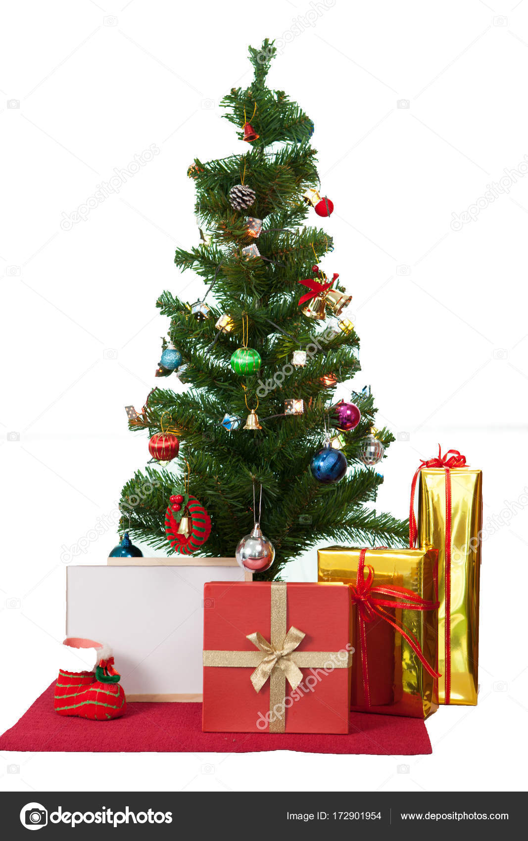 decorated christmas tree and gift boxes on white background photo by ekachais