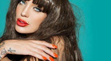 Beautiful Woman With Orange Lipstick